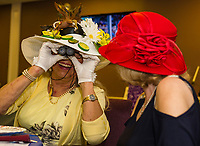 Susan Branche and Shela Cunningham sport their Kentucky Derby hats during the Unitarian Universalist Society of Laconia's Kentucky Derby party on Saturday evening at the Beane Center.   (Karen Bobotas/for the Laconia Daily Sun)