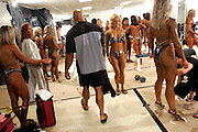 Scott Morgan\The Hawk Eye.Genkinger gathers his clothes and bag in the dressing area after the competition as fitness competitors get ready for their turn on stage Saturday, June 16, 2007 at the competition in Rosemont, Ill. Chris knew he was out of contention for a top spot in the competition by when he was called out to show during the group showing.