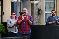 © Licensed to London News Pictures. 30/04/2020. London, UK. Members of the public in Haringey, north London take part in 'Clap For Our Carers' by applauding NHS staff, carers and key workers. The campaign has been encouraging people across the UK to take part in a round of applause from their windows, doors and front gardens to show their appreciation for the efforts of the NHS staff, carers and key workers during the COVID-19 pandemic. Photo credit: Dinendra Haria/LNP