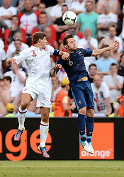 Yohann CABAYE and Steven GERRARD of England during the 1-1 draw in the Group D Match Against France AT The Euro 2012 Football Championships in Donetsk, Ukraine, June 11 2012. Photo By Imago/i-Images