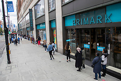 © Licensed to London News Pictures. 14/06/2020. London, UK. Shoppers Socially distance as they queue outside a branch of Primark on Oxford Street. Non Essential shops reopened on the 15 of June. Photo credit: George Cracknell Wright/LNP