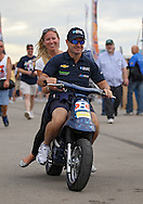 Rubens Barrichello leaves an autograph session on a motorbike before the start of the IZOD IndyCar Iowa Corn Indy 250 auto race at the Iowa Speedway in Newton, Iowa on Saturday, June 23, 2012.