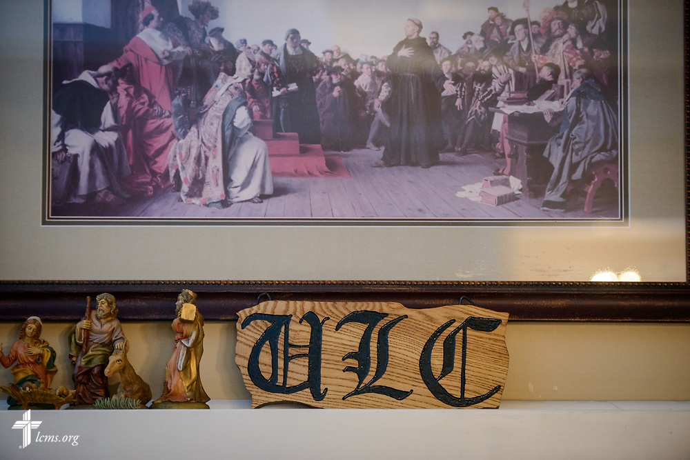 A woodcut of University Lutheran Chapel under a reproduction of a painting depicting Martin Luther at Luther House on Wednesday, Feb. 21, 2018, next to the University of Minnesota, Twin Cities, in Minneapolis. LCMS Communications/Erik M. Lunsford
