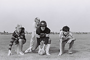 Teenagers playing American football, London, UK, 1982