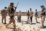 Libya: Libya's Government of National Accord's (GNA) fighters take cover from ISIS snipers in 700 neighbourhood in Sirte. Alessio Romenzi