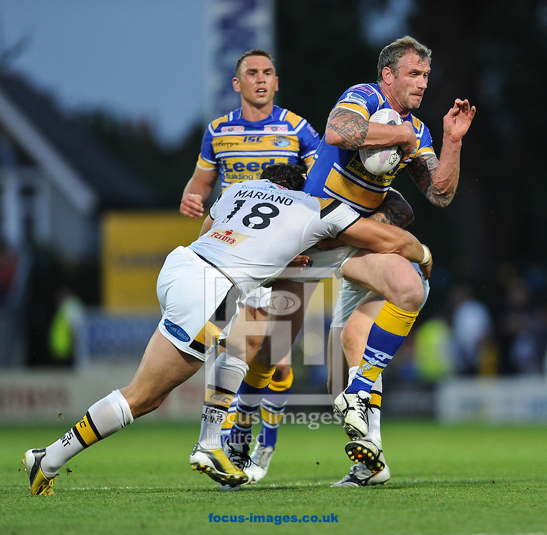 Jamie Peacock of Leeds Rhinos is stopped by Frankie Mariano of Castleford Tigers during the First Utility Super League match at Headingley Carnegie Stadium, Leeds<br /> Picture by Richard Land/Focus Images Ltd +44 7713 507003<br /> 17/07/2014