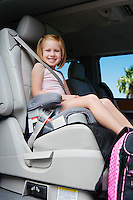Girl Riding in Booster Seat