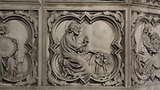 Detail of bas-relief sculpture, mid 13th century, on the base of the portal of the Upper chapel of La Sainte-Chapelle, Paris, France. One of a series of reliefs illustrating scenes from the Old Testament book of Genesis. Here we see God creating Day and Night. Each panel has a decorated curly frame with mythical beasts in the corner. Sainte Chapelle was built 1239-48 to house King Louis IX's collection of Holy Relics. It is a UNESCO World Heritage Site. Picture by Manuel Cohen.