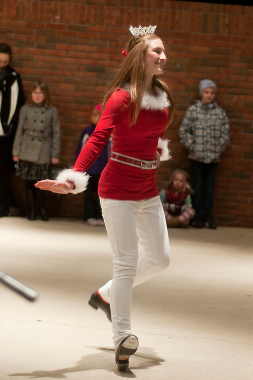 Lathan Goumas | The Bay City Times..Junior Miss Bay County Sarah Anderson tap dances for a crowd of people awaiting the arrival of Santa and Mrs. Claus at Wenonah Park in Bay City, MI. on Friday November 25, 2011.