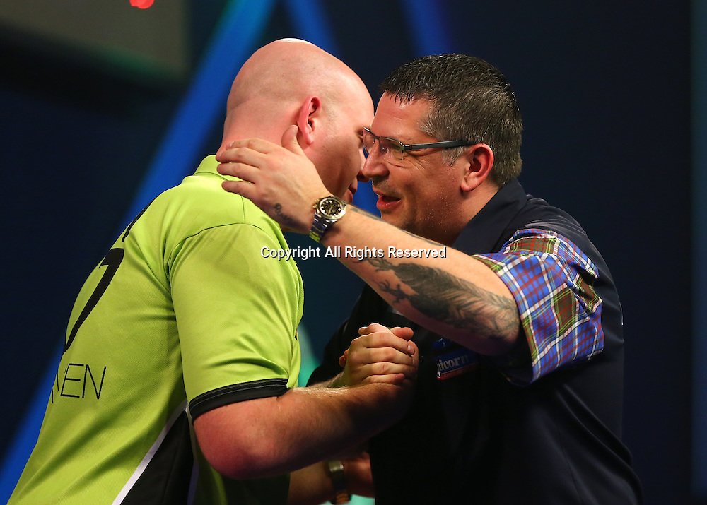 02.01.2017. Alexandra Palace, London, England. William Hill PDC World Darts Championship final  between top seeds Michael van Gerwen (1) and Gary Anderson (2). Michael van Gerwen is congratulated by  Gary Anderson, after he wins the World Darts Final 7 sets to 3