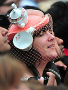 A woman with a tea pot inspired hat watches as Princess Catherine arrives at Westminster Abbey for her wedding to Prince William in London on April 29, 2011.  UPI/Kevin Dietsch