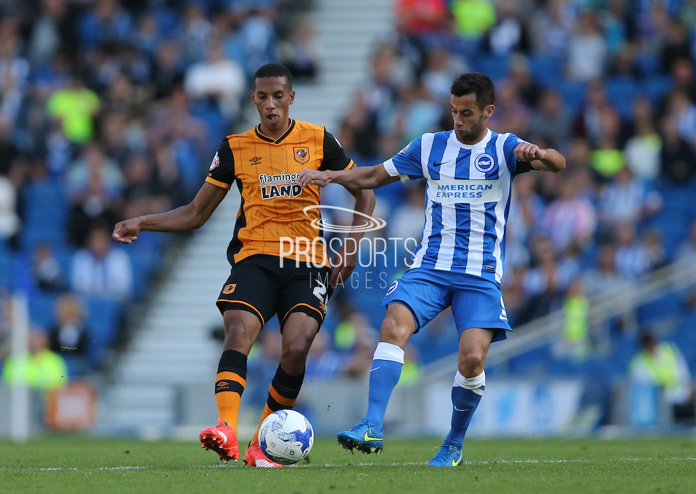 Hull City defender Isaac Hayden closes down Brighton striker, Sam Baldock the Sky Bet Championship match between Brighton and Hove Albion and Hull City at the American Express Community Stadium, Brighton and Hove, England on 12 September 2015.