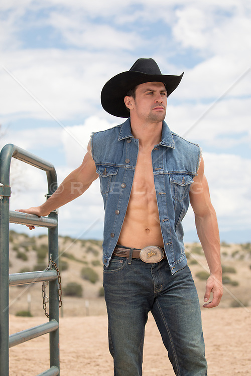 hot muscular cowboy with an open shirt on a ranch