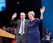 Conservative Annual Conference, Manchester Central, Manchester, Great Britain <br /> Day 4<br /> 4th October 2017 <br /> <br /> Theresa May MP<br /> Leader of the Conservatives makes her Leaders' speech at the end of the 4 day conference in Manchester. <br /> <br /> <br /> with husband Philip waving to delegates after speech <br /> <br /> Photograph by Elliott Franks <br /> Image licensed to Elliott Franks Photography Services