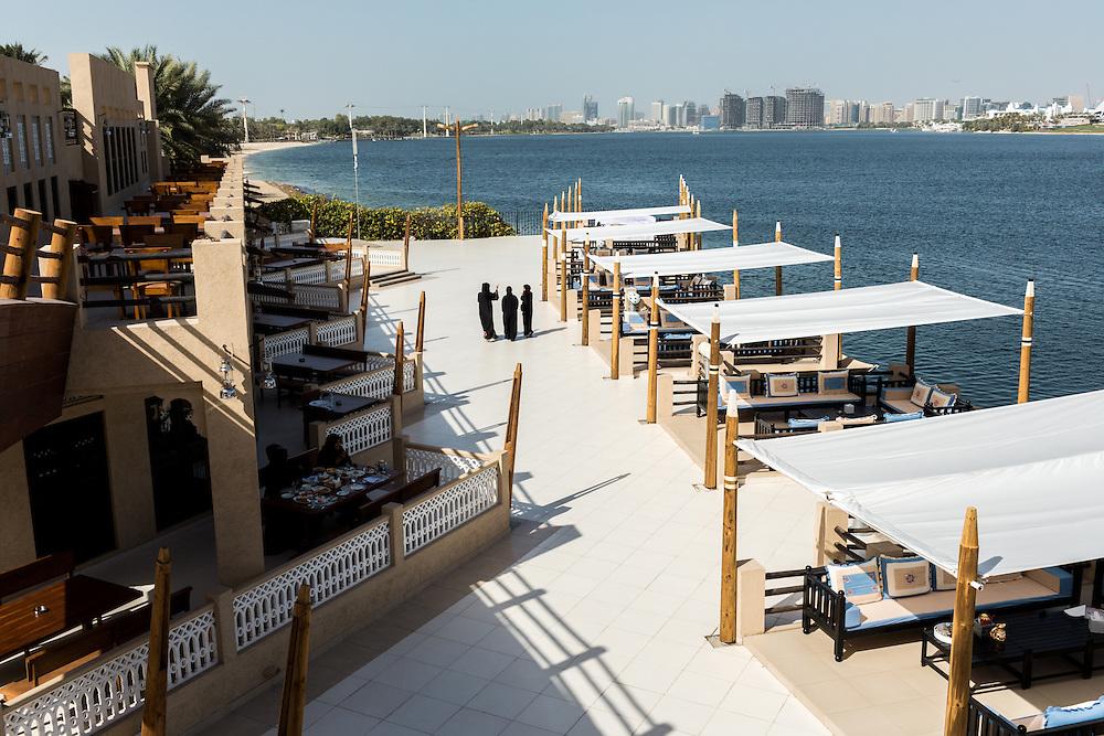 DUBAI, UAE - DECEMBER 11, 2015: Zaman Awal signature restaurant is located in Al Boom Tourist Village with views on the Deira skyline and the Dubai Creek.