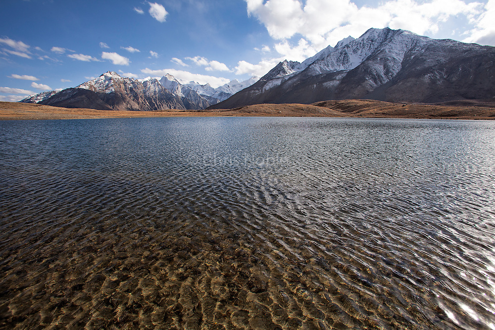 An alpine lake beneath the Greater Himalaya Range on the way into the Zanskar Valley over the Penzi La Pass.