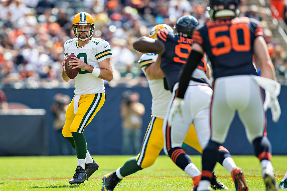 CHICAGO, IL - SEPTEMBER 13:  Aaron Rodgers #12 of the Green Bay Packers looks downfield for a receiver during a game against the Chicago Bears at Soldier Field on September 13, 2015 in Chicago, Illinois.  The Packers defeated the Bears 31-23.  (Photo by Wesley Hitt/Getty Images) *** Local Caption *** Aaron Rodgers