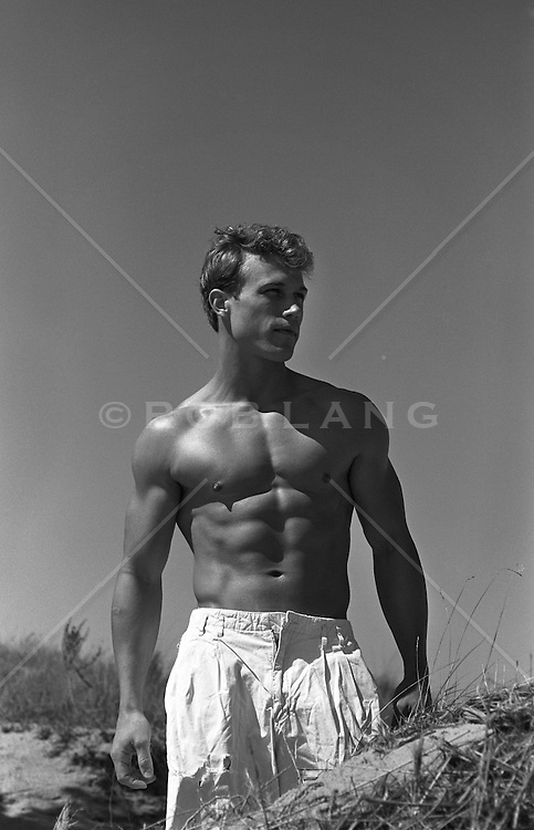 Toned man at the beach in East Hampton, NY