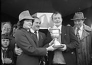 "Jameson Gold Cup At Punchestown.     (N72)..1981..29.04.1981..04.29.1981..29th April 1981. .The Jameson Gold Cup at Punchestown,Naas ,Co Kildare,was won today by ""Owens Image"" owned by Mrs Rosemary Garvey. The horse was ridden by Mr F Berry and was trained by Mr P Hughes. Mrs Betty Bohan,wife of Mr Eddie Bohan,Past President,Vitners Federation of Ireland,made the presentation of The Gold Cup after the race..Image shows Mrs Betty Bohan presenting the Gold Cup to Mr Eugene Garvey,husband of the owner of ""Owens Image"", Mrs Rosemary Garvey. Included in the image is Mr Eddie Bohan."