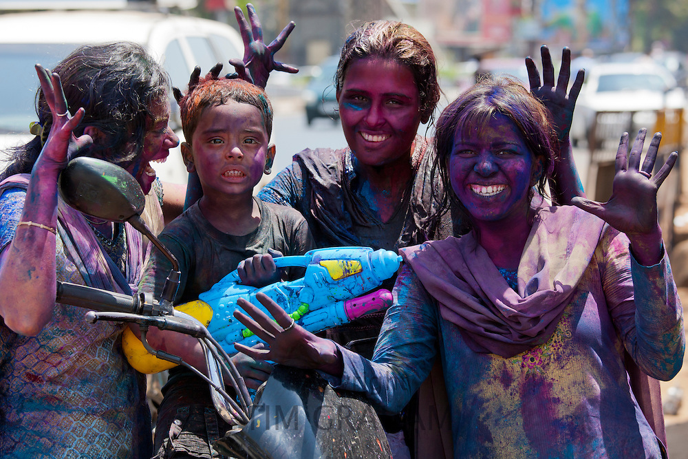 Indian people celebrate Hindu Holi festival of colours with powder paints in Mumbai, India