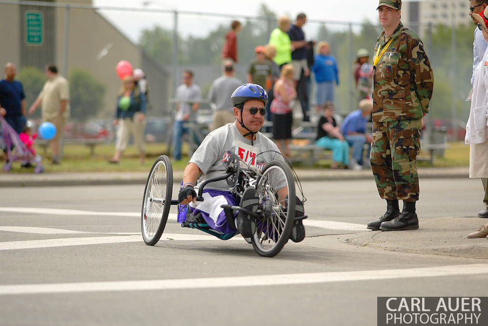 July 4th, 2006:  Anchorage, Alaska - Ignacio Franco (514) enters turn one of the 26th National Veterans Wheelchair Games 5k Handcycle race.