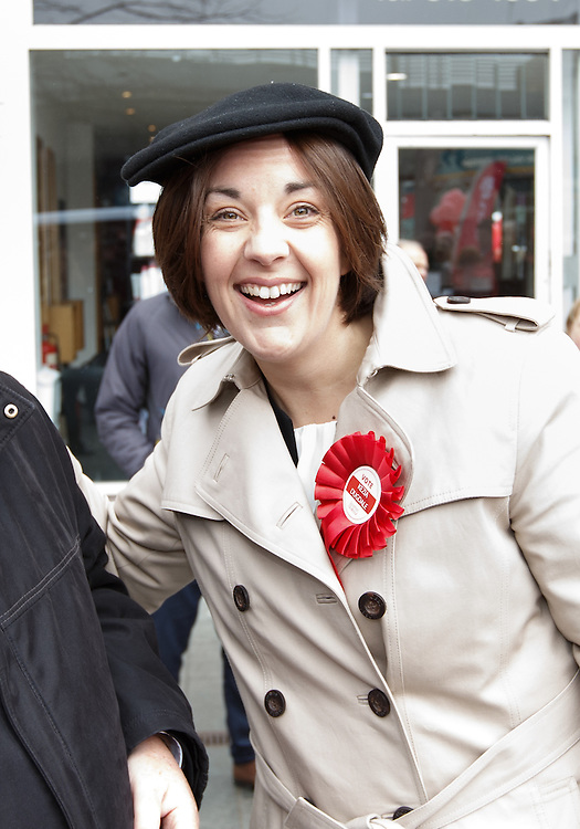 Scottish Labour leader marks first full day of Scottish Parliament election campaign. Kezia Dugdale to join Rutherglen candidate James Kelly and party supporters for a street stall and walkabout in Rutherglen, Glasgow. She borrows BBC Scotland's Brian Taylor's hat for a joke. Picture Robert Perry 24th March 2016<br /> <br /> Must credit photo to Robert Perry<br /> FEE PAYABLE FOR REPRO USE<br /> FEE PAYABLE FOR ALL INTERNET USE<br /> www.robertperry.co.uk<br /> NB -This image is not to be distributed without the prior consent of the copyright holder.<br /> in using this image you agree to abide by terms and conditions as stated in this caption.<br /> All monies payable to Robert Perry<br /> <br /> (PLEASE DO NOT REMOVE THIS CAPTION)<br /> This image is intended for Editorial use (e.g. news). Any commercial or promotional use requires additional clearance. <br /> Copyright 2014 All rights protected.<br /> first use only<br /> contact details<br /> Robert Perry     <br /> 07702 631 477<br /> robertperryphotos@gmail.com<br /> no internet usage without prior consent.         <br /> Robert Perry reserves the right to pursue unauthorised use of this image . If you violate my intellectual property you may be liable for  damages, loss of income, and profits you derive from the use of this image.