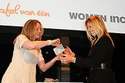 Prinses Maxima geeft de Amsterdamse Beurs van Berlage het startschot voor een nieuw landelijk project van WOMEN Inc. Het project wil het belang van economische zelfstandigheid van vrouwen onderstrepen. /// Princess Maxima, the Amsterdam Beurs van Berlage is launching a new national project of WOMEN Inc.. The project will study the importance of economic independence of women underline.<br /> <br /> Op de foto: On the Photo:<br /> <br />  Prinses Maxima krijgt dinsdag een waardepapier van Jannet Vaessen (L, algemeen directeur van WOMEN Inc.) in de Amsterdamse Beurs van Berlage. //// Princess Maxima gets Tuesday a paper value of Jannet Vaessen (L, CEO of WOMEN Inc.). Beurs van Berlage in Amsterdam
