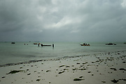 Fishermen at low tide on the east coast of Zanzibar