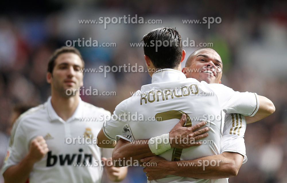 06.11.2011, Santiago Bernabeu Stadium, Madrid, ESP, Primera Division, Real Madrid vs CA Osasuna, im Bild  Real Madrid's Cristiano Ronaldo celebrates with Pepe // during Primera Division league football match between Real Madrid an CA Osasuna at Santiago Bernabeu Stadium, Madrid, Spain on 06/11/2011. EXPA Pictures © 2011, PhotoCredit: EXPA/ Alterphoto/ Alvaro Hernandez +++++ ATTENTION - OUT OF SPAIN/(ESP) and OUT OF SWISS/(SUI) ++++