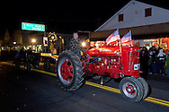 Pine Bush, New York - People enjoy the tractor parade during the Community Country Christmas presented by the Pine Bush Chamber of Commerce on Dec. 1, 2012.