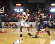 """Ole Miss' Jarvis Summers (32) vs. Auburn guard Josh Wallace (11) at the C.M. """"Tad"""" Smith Coliseum on Saturday, February 23, 2013."""