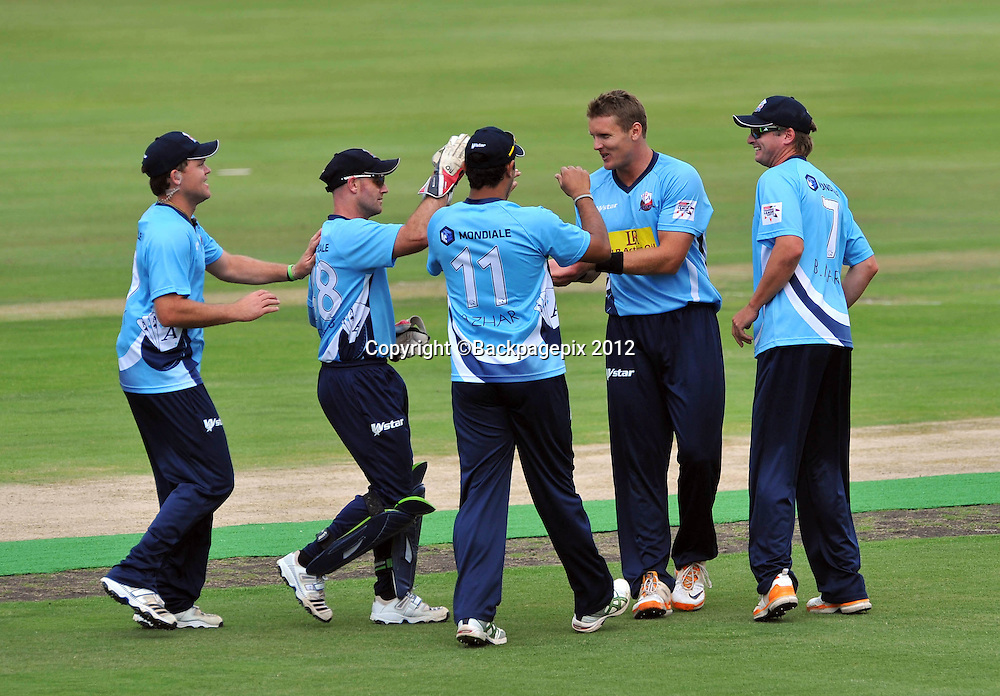 Michael Bates of Auckland Aces celebrates with his teammates after taking the wicket of Herschelle Gibbs of Perth Scorchers during the 2012 Champions League Twenty20 cricket match between the Perth Scorchers and the Auckland Aces at Supersport Park in Centurion, South Africa on 23 October 2012 ©Chris Ricco/BackpagePix