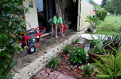 September 10, 2017 - Wellington, Florida, U.S. - Stan Taylor watches hurricane Irma from his back porch in Wellington, Florida on September 10, 2017. Taylor unpacked his never used generator purchased after hurricane Wilma to power his refrigerator. Taylor's power went out early Sunday morning. (Credit Image: © Allen Eyestone/The Palm Beach Post via ZUMA Wire)