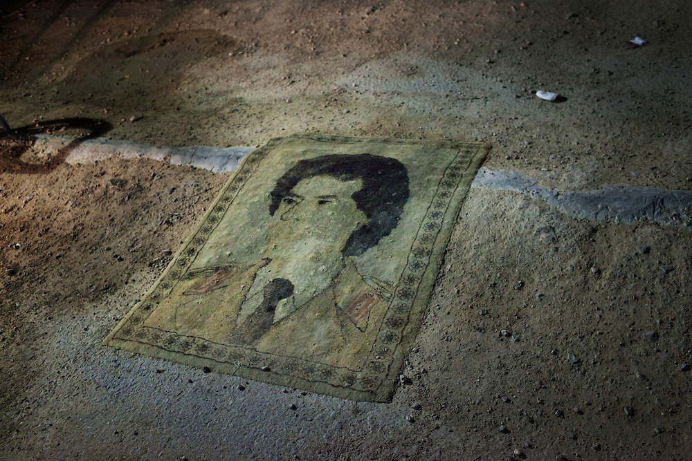 A Qaddafi portrait carpet in a check point in the desert region between Bani Walid and Misrata.