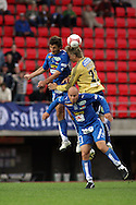 19.07.2006, Ratina, Tampere, Finland..Veikkausliiga 2006 - Finnish League 2006.Tampere United - HJK Helsinki.Vasile Marchis & Ville Lehtinen (TamU) v Markus Halsti (HJK).©Juha Tamminen.....ARK:k