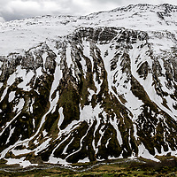 Alpine landscape on the route up to the Furka Pass from the Reuiss Valley in Uri Canton, just after it opened after a seven month winter. Historically this area, around Uri belonged to the National Redoubt, the final Swiss line of defence in the high alps, and is checked with the remains of millitray installations, many of them underground, still camouflaged.