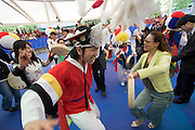 Seoul Nori Madang open-air folcloric theatre. Drummers and dancers from Jindo. Inviting spectators for a dance after the performance.