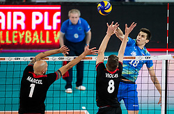 Marcel Gil Keller and Tiago Da Silva Violas of Portugal vs Klemen Cebulj of Slovenia during volleyball match between National teams of Slovenia and Portugal in 2nd Round of 2018 FIVB Volleyball Men's World Championship qualification, on May 26, 2017 in Arena Stozice, Ljubljana, Slovenia. Photo by Vid Ponikvar / Sportida