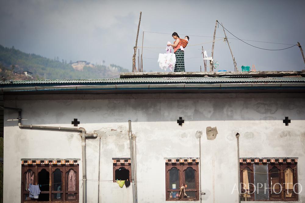 Hanging out washing on the rooftop Thimphu Bhutan Asia Thimphu, Bhutan
