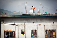 Hanging out washing on the rooftop Thimphu Bhutan Asia Thimphu, Bhutan