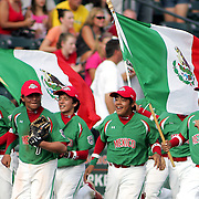 8/22/10 Aberdeen, MD: Mexico players celebrate by jogging around the field with their flags after beating Ocala Florida 7-1 at The Cal Ripken World Series in Aberdeen MD.