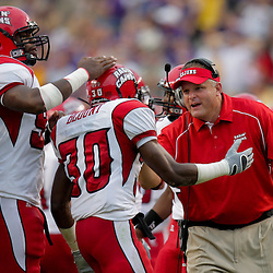 19 September 2009: Louisiana-Lafayette Cajuns defensive coordinator Kevin Fouquier congratulates safety Gerren Blount (30) after an interception in the first half of a game against the  LSU Tigers at Tiger Stadium in Baton Rouge, Louisiana.