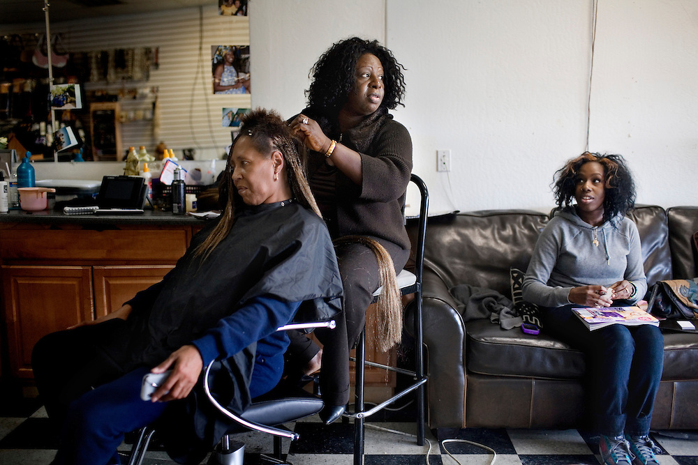 "Doris Campbell, 45, braids the hair of Annie Davis, 56, with her daughter, Hawa Fallay, 23 at right, in her beauty shop, My African Heritage, in the ""infamous Crest,"" short for Hillcrest, a neighborhood in North Vallejo that was known for national rap artists Mac Dre and Mac Mall, in Vallejo, Ca., on Wednesday, Feb. 10, 2010. ""Idle minds is the devil's playground,"" says Campbell, of today's youth not having enough resources to turn to and away from crime and drugs."
