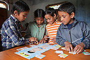 Children use of on the learning aids at the Alternate Learning Hub, Subhai, Himalayas, India. The school is organized and funded by the Pragya charity.  Pragya is a non-profit organization providing education and information services in high altitude areas in the Himalayas.