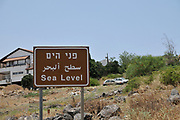 Israel, Galilee, Sea Level sign on the road to the Sea of Galilee that lies 212 meters below sea level
