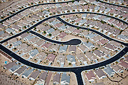 "Curvilinear roads and cul-de-sacs create communities that are difficult to navigate and disorienting.    Repetitive ""snout-nosed"" (garage in front) houses and marginally interconnected streets add to suburban isolation."
