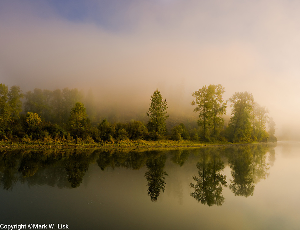 Fog rises in the Clearwater National Forest over the Saint Joe River.