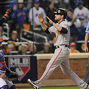 NEW YORK, NEW YORK - October 5: Conor Gillaspie #21 of the San Francisco Giants celebrates at home plate after hitting a three run home run in the top of the ninth during the San Francisco Giants Vs New York Mets National League Wild Card game at Citi Field on October 5, 2016 in New York City. (Photo by Tim Clayton/Corbis via Getty Images)