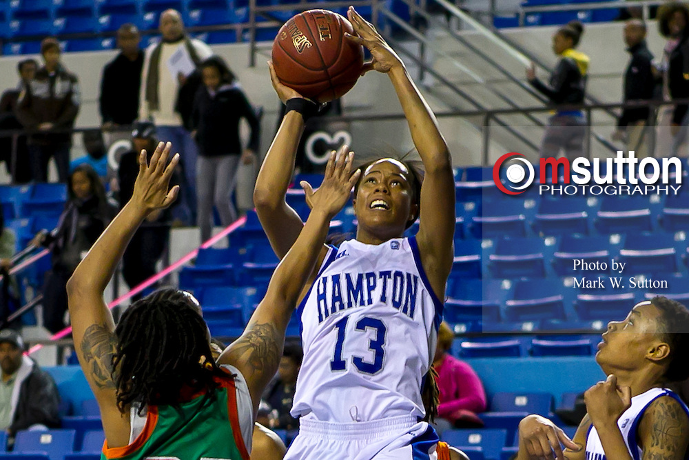 Hampton Lady Pirates forward Keiara Avant (13) pulls up for this jumper during the Hampton - Florida A&M NCAA basketball game played at the Hampton Convocation Center in Hampton, Virginia.  March 02, 2013  Hampton Lady Pirates won 59-39.  (Photo by Mark W. Sutton)