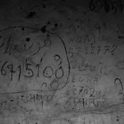 Phone numbers handwritten on the walls of houses.<br /> <br /> N&uacute;meros de tel&eacute;fono manuscritos en las paredes de las casas.